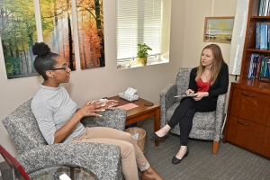 Student Speaking with Therapist